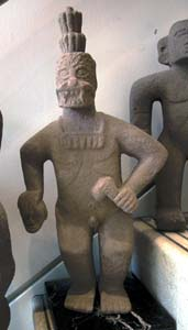 Basalt Sculpture Of A Masked Figure