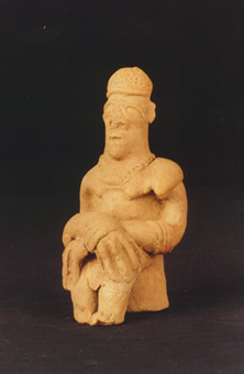 Komaland Sculpture of a Seated Man