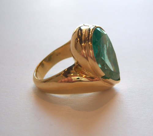 18 Karat Gold Ring Set with a Pear-Shaped Colombian Emerald