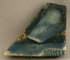 Ptolemaic Glass Inlay of a Skirt