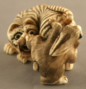 Ivory Netsuke Depicting a Tiger Chasing a Rabbit