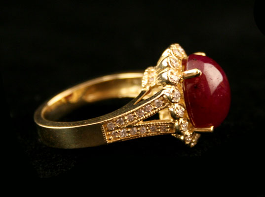 18 Karat Gold Ring Featuring a Cabochon Ruby with 50 Diamonds