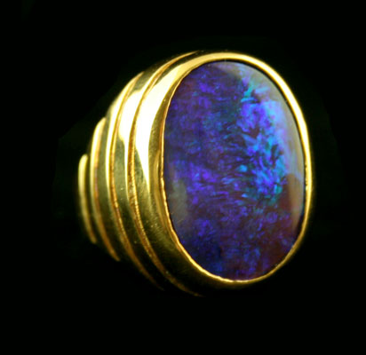 18 Karat Gold Ring Featuring a Boulder Opal