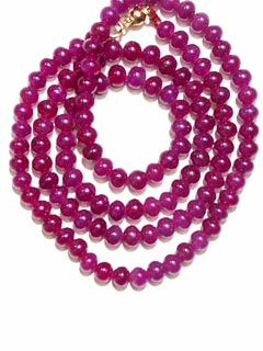 Necklace Composed Of Genuine Ruby Beads With A 14 Karat Gold Clasp