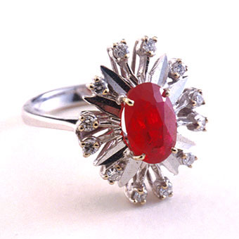 White Gold Ring Featuring a Ruby Surrounded by Twelve Diamonds