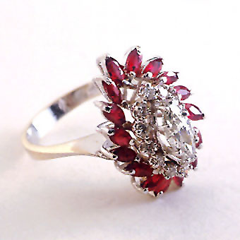 White Gold Ring Featuring Thirteen Diamonds and Sixteen Rubies