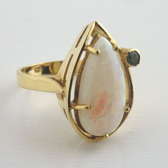 Ring Of 18 Karat Gold Set With A Pear-Shaped Opal And A Genuine Emerald