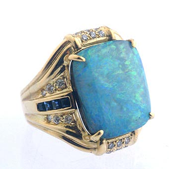 Gold Ring Featuring an Australian Opal Embellished with 24 Diamonds and 8 Sapphires