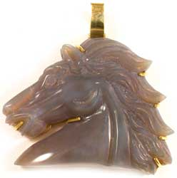 Carved Lavendar Opal Depicting A Horse Head