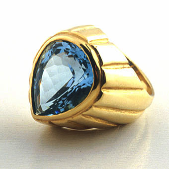 18 Karat Gold Ring Set with a Blue Topaz