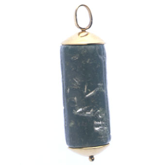 Gold Pendant Featuring a Black Diorite Cylinder Seal