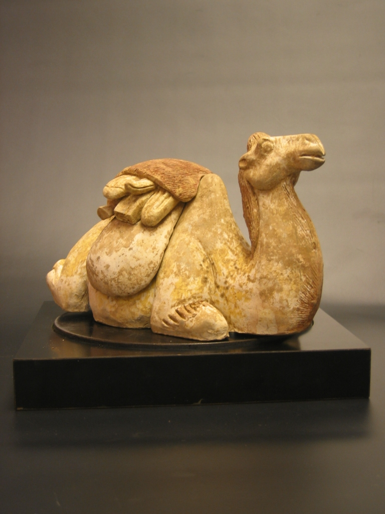 Early Tang Painted Pottery Seated Camel with Detachable Saddle