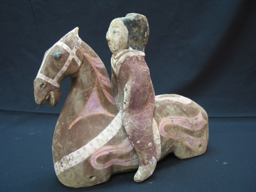 A Pair of Han Dynasty Painted Pottery Seated Horses with Detachable Riders
