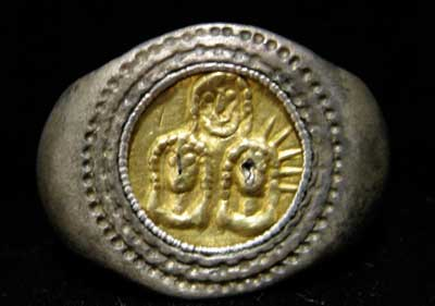 Silver Ring with Gold Inlay Featuring Three Heads