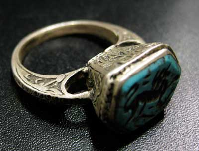 Turquoise Zoomorphic Seal Set in a Silver Ring