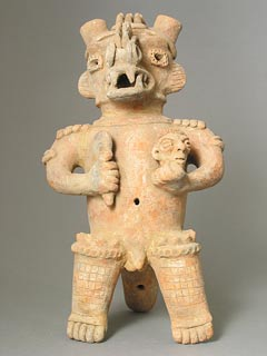 Sculpture of a Standing Saurian Deity Holding a Club and a Head