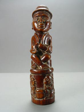 Kongo Ivory Sculpture of a Seated Man