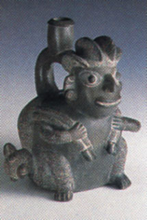 Chavin Blackware Stirrup Vessel in the Form of a Seated Hunter