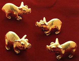 Four Gold Pendants of Peccaries