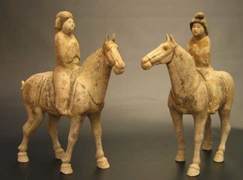 A Pair of Tang Dynasty Painted Pottery Fat Ladies on Horses