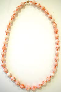 Necklace Composed Of Genuine Coral Beads And With A 14 Karat Gold Clasp