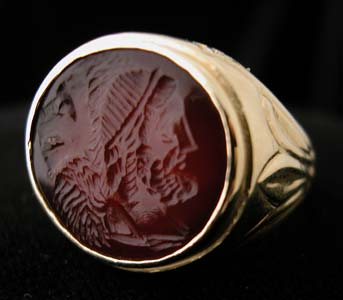 Gold Ring with Classical Revival Carnelian Intaglio of a Deity and a Lion