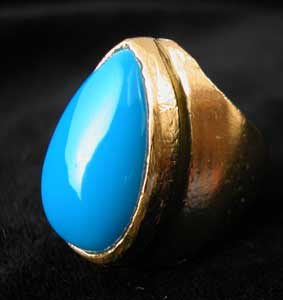 Gold Ring Featuring a Turquoise Stone