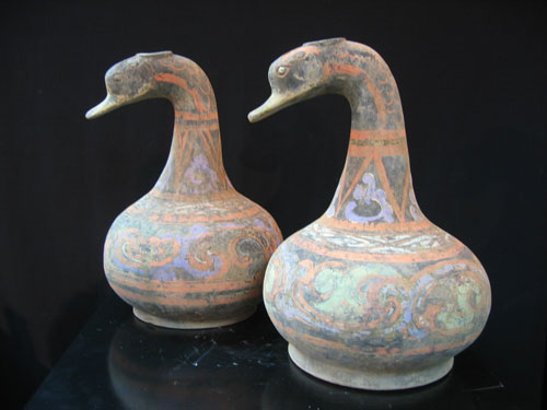Pair of Han period terracotta vessels, in the form of a duck