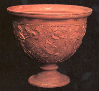 Footed Cup With Molded Decorations