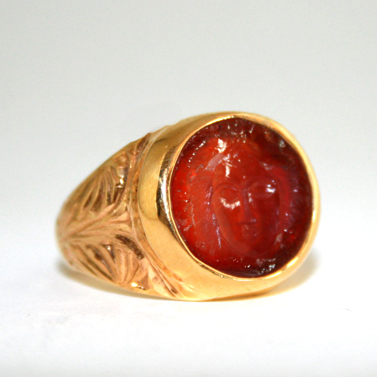 Carnelian Intaglio Depicting the head of Medussa mounted in an 18 Karat Gold Ring