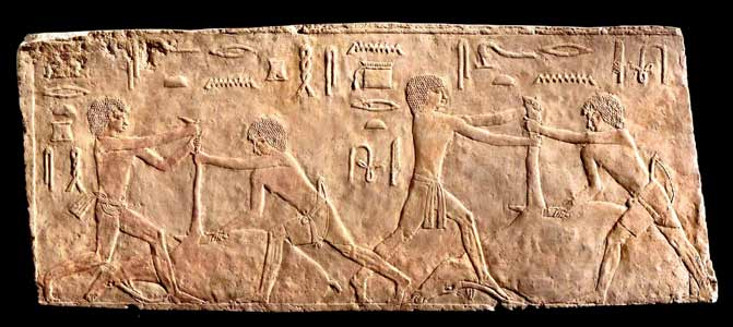 Egyptian Limestone Relief Fragment Depicting a Slaughtering Scene