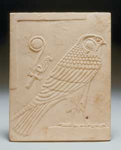 Egyptian Double-Sided Limestone Plaque Depicting a Falcon and a Head