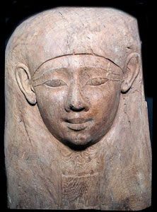 Fragment of an Egyptian Wooden Sarcophagus Depicting a Head